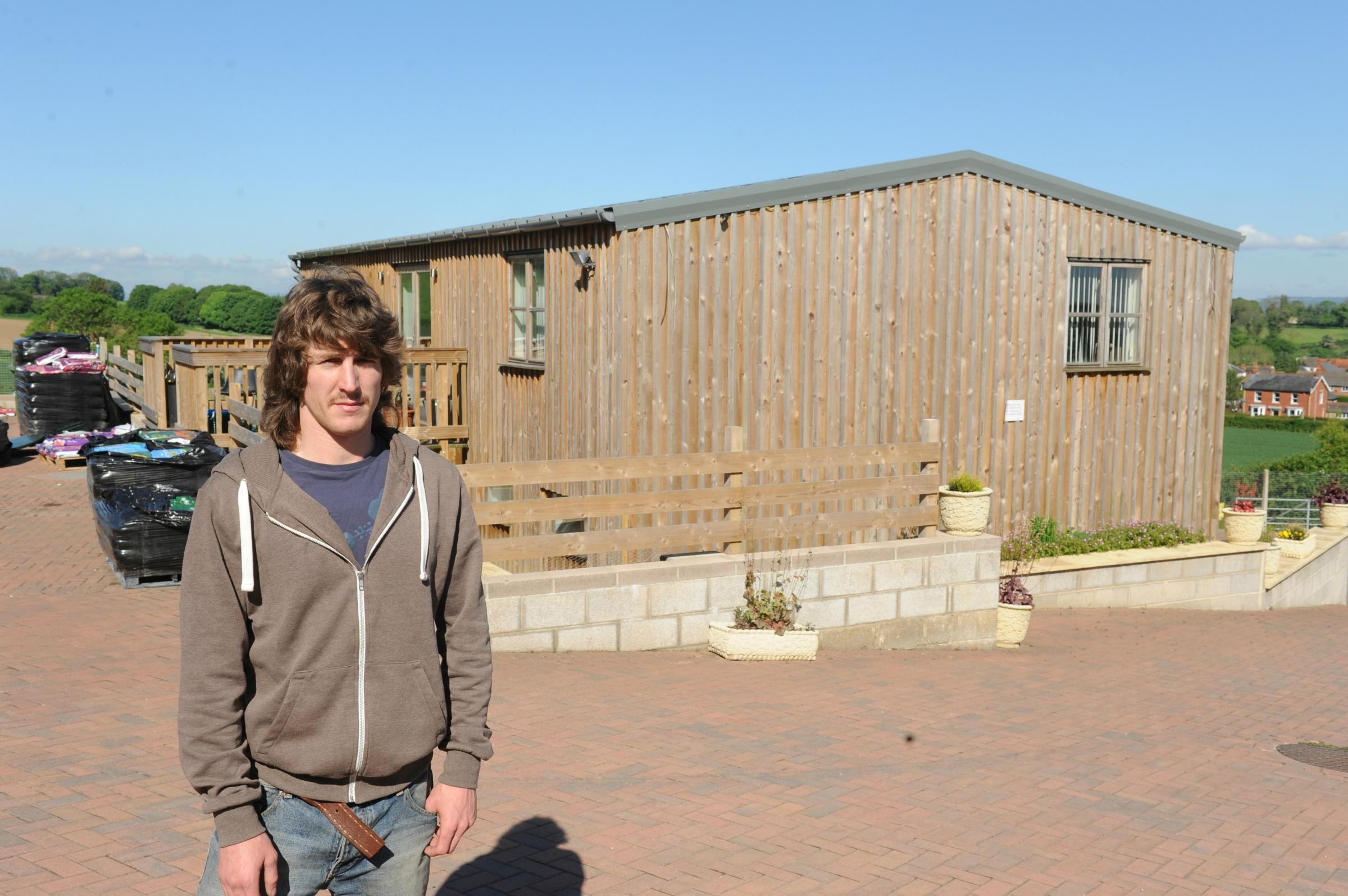 Bradley Winchle of Fourboys Garden Centre in Dursley next to the building that has to reduced in height (6410421)