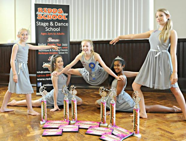 REDDS Stage and Dance School competition group Brodie Shutt,11, Lily Griffiths,14, Rhian Steeter,12, Milan Cacacie,14, and Elle Shephhard,15, with the trophies they won at the recent Starpower dance competition
