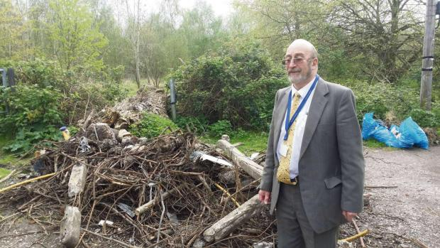 Cllr Robert Griffin with fly tipped green waste in Bolsters Lane, Easter Compton (6389214)