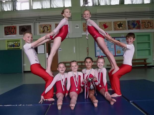 The Ridge Junior School gymnasts with their medals