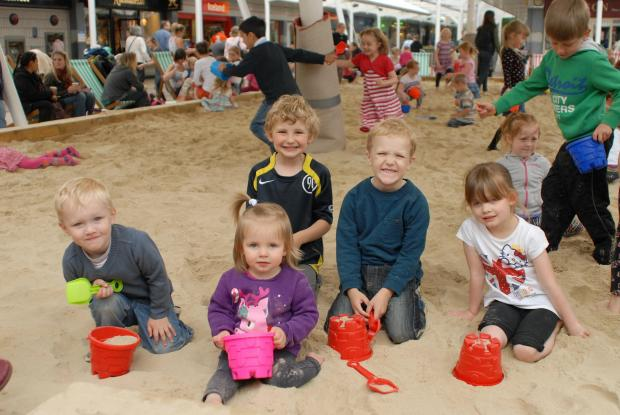 Children playing on the beach in Yate Shopping Centre on Tuesday