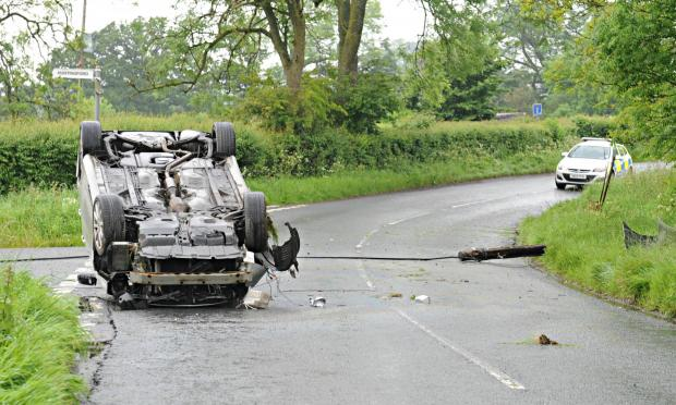 Stumpwell Lane at the junction of Swinhay Lane near Bradley Green was blocked on Wednesday morning after this car hit a electricity post and rolled onto its roof (6588988)