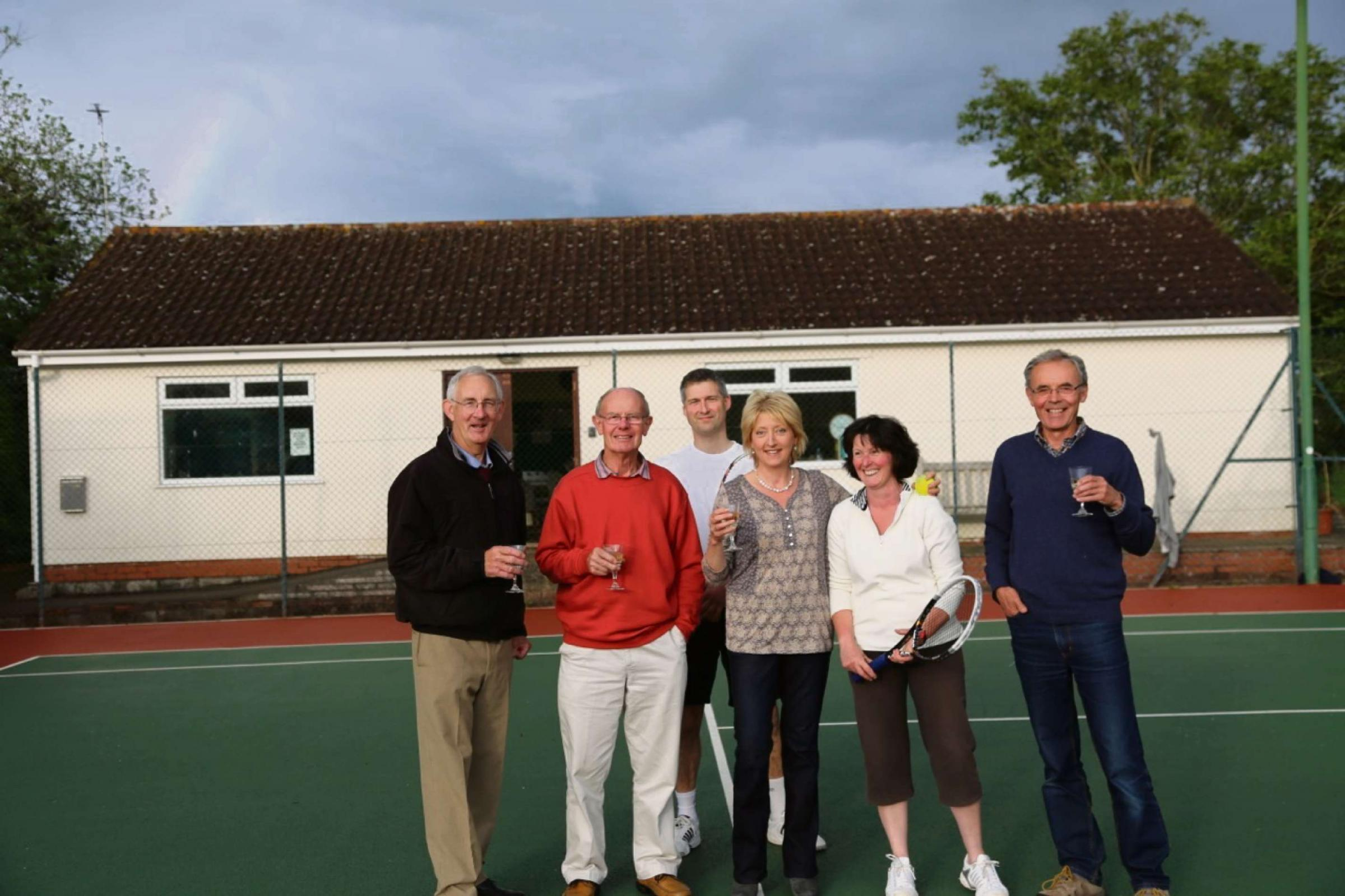 Thornbury Tennis Club members celebrate in front of their clubhouse
