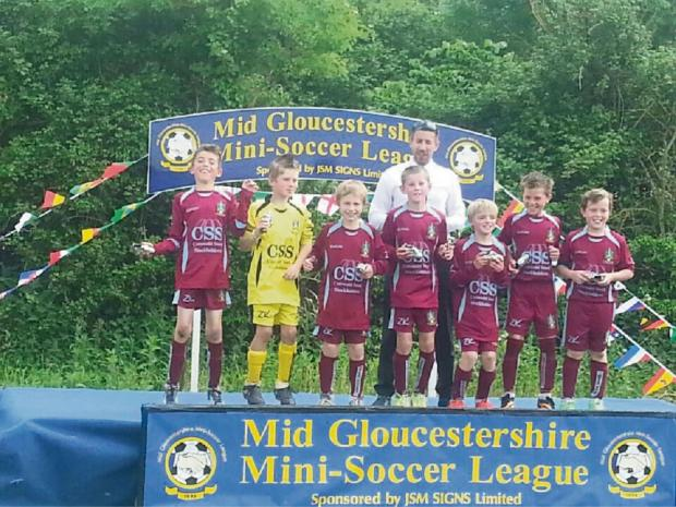 Wotton Rovers U10s collecting their medals