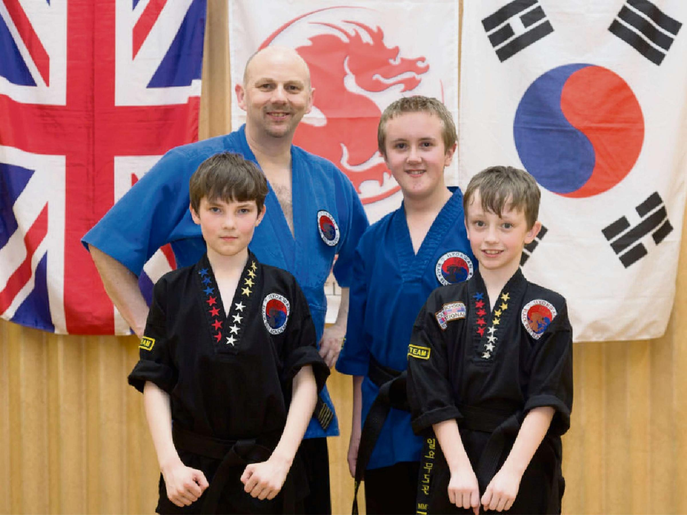 Back row:  Richard Olpin, 6th Dan, and Robbie Hirst,  Junior 2nd Dan. Front row: Dillon Callinan and Harvey Smith (newly promoted junior black belts)