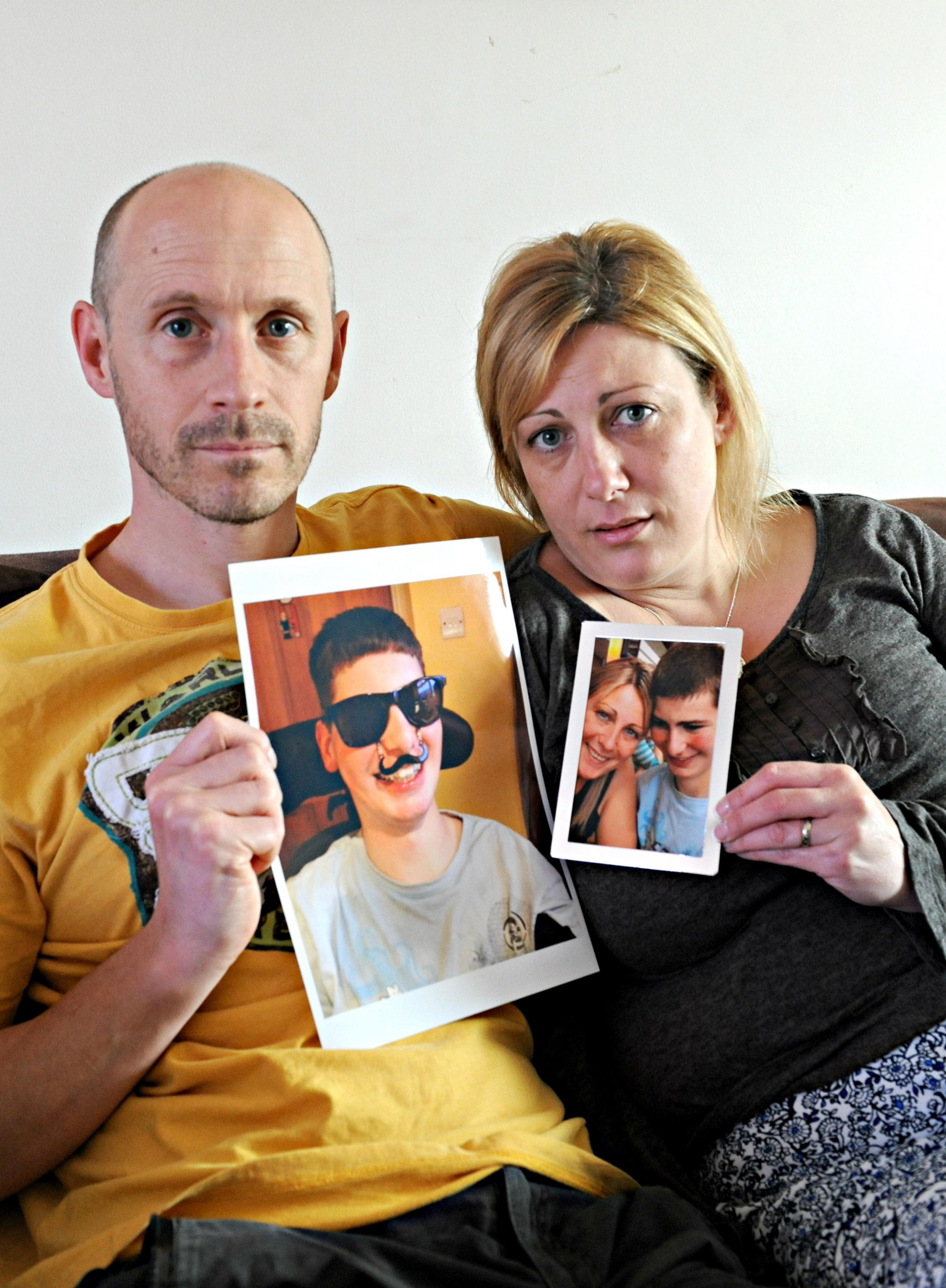 Rob and Caroline Easthope with their favourite pictures of their son Josh Marsh, who died last month at the age of 19