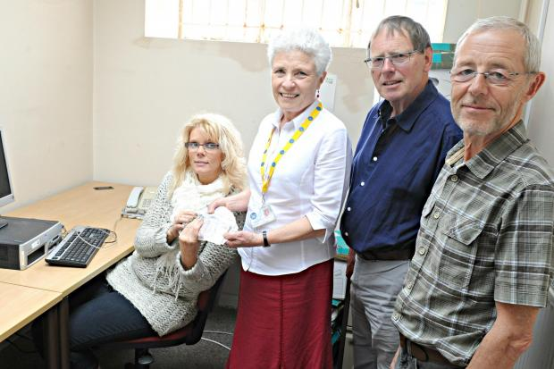 Sandra Davies of The Swan in Thornbury presented £1125 to Judy Roberts, Quentin Killey and John Snowden of the Thornbury Citizens Advice Bureau. The money will be used to buy new computers (6411723)