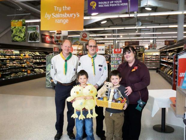 Brothers William and Isaac Irvine pictured won an Easter trail competition at Sainsbury's, with the proceeds going to First Dursley Scouts. The lucky winners received their prizes f