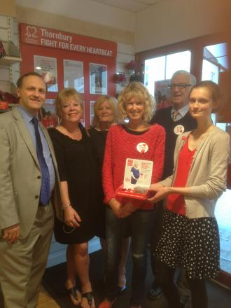 Steve Webb MP and Teresa Dovey along with volunteer helpers at the Thornbury British Heart Foundation shop
