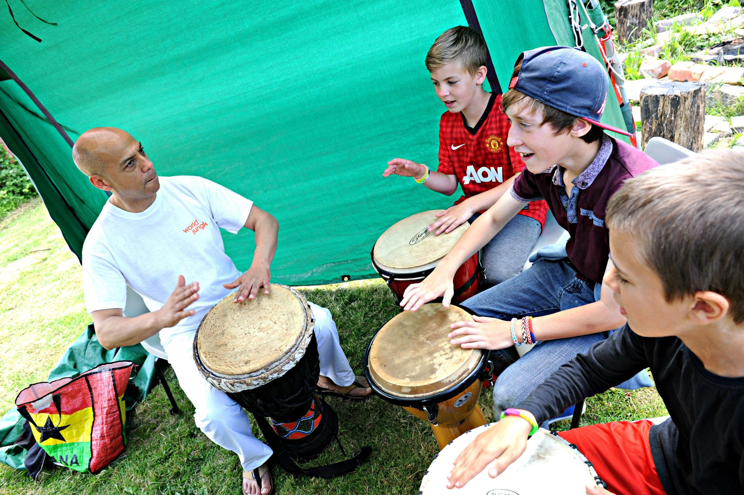 Richard Davis of World Jungle with Max Creamer,11, Isaac Evans,12 and Stephen Sims,12, at the World Cup Fun Day at the Chantry in Dursley on Saturday (7178967)