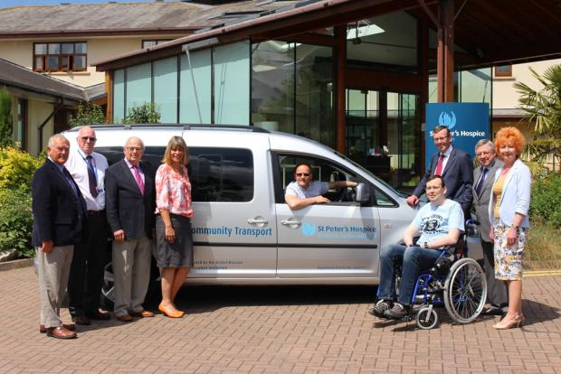 Gazette Series: Marc Willetts, from the Bristol Masonic Benevolent Institute, with Simon Caraffi, chief executive of St Peter's Hospice (standing to the right of the bus) and members of the mason with patients and their families
