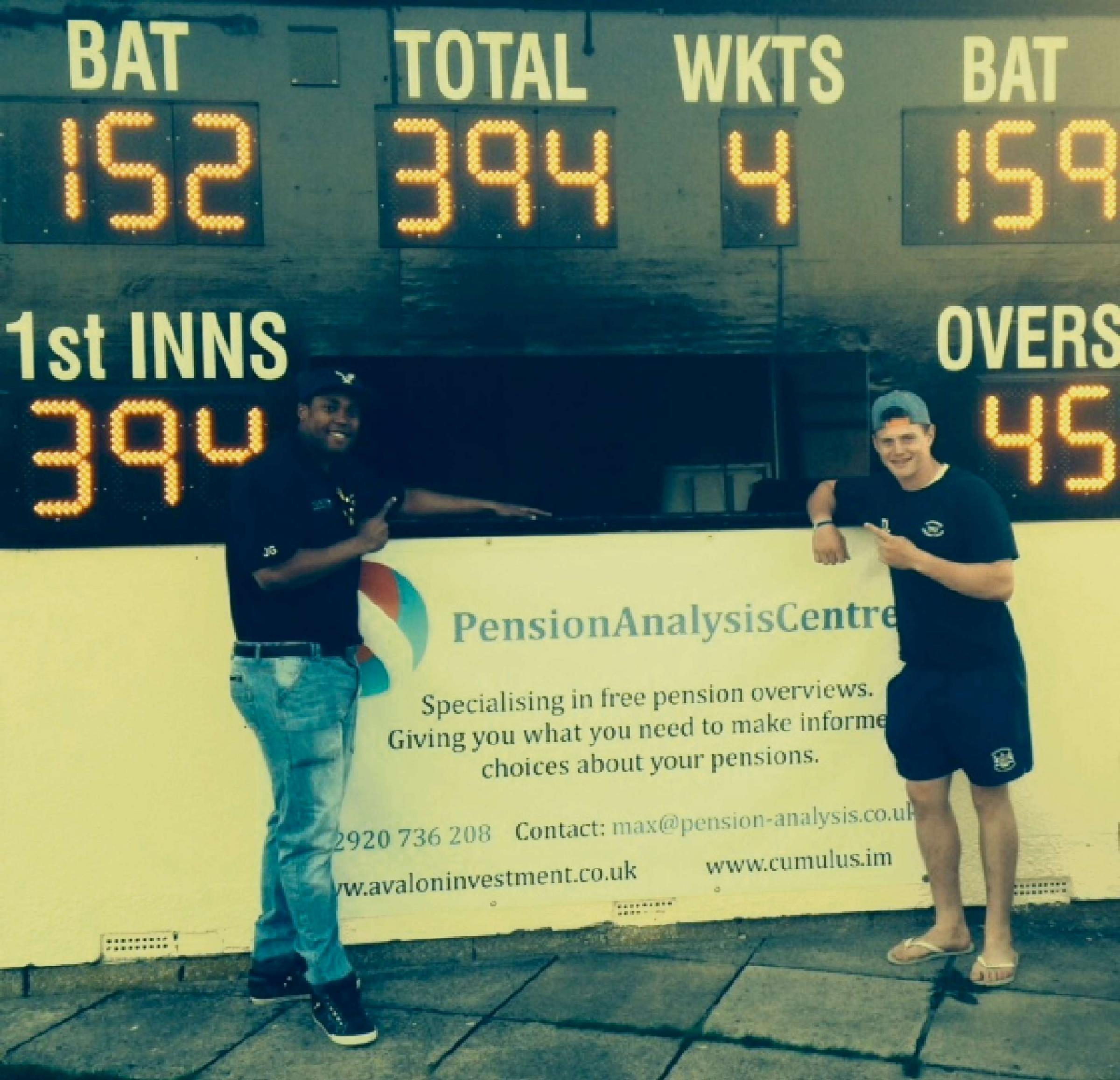 Centurions Juvaunie Gayle and Dan Lezar by the scoreboard showing Thornbury's record