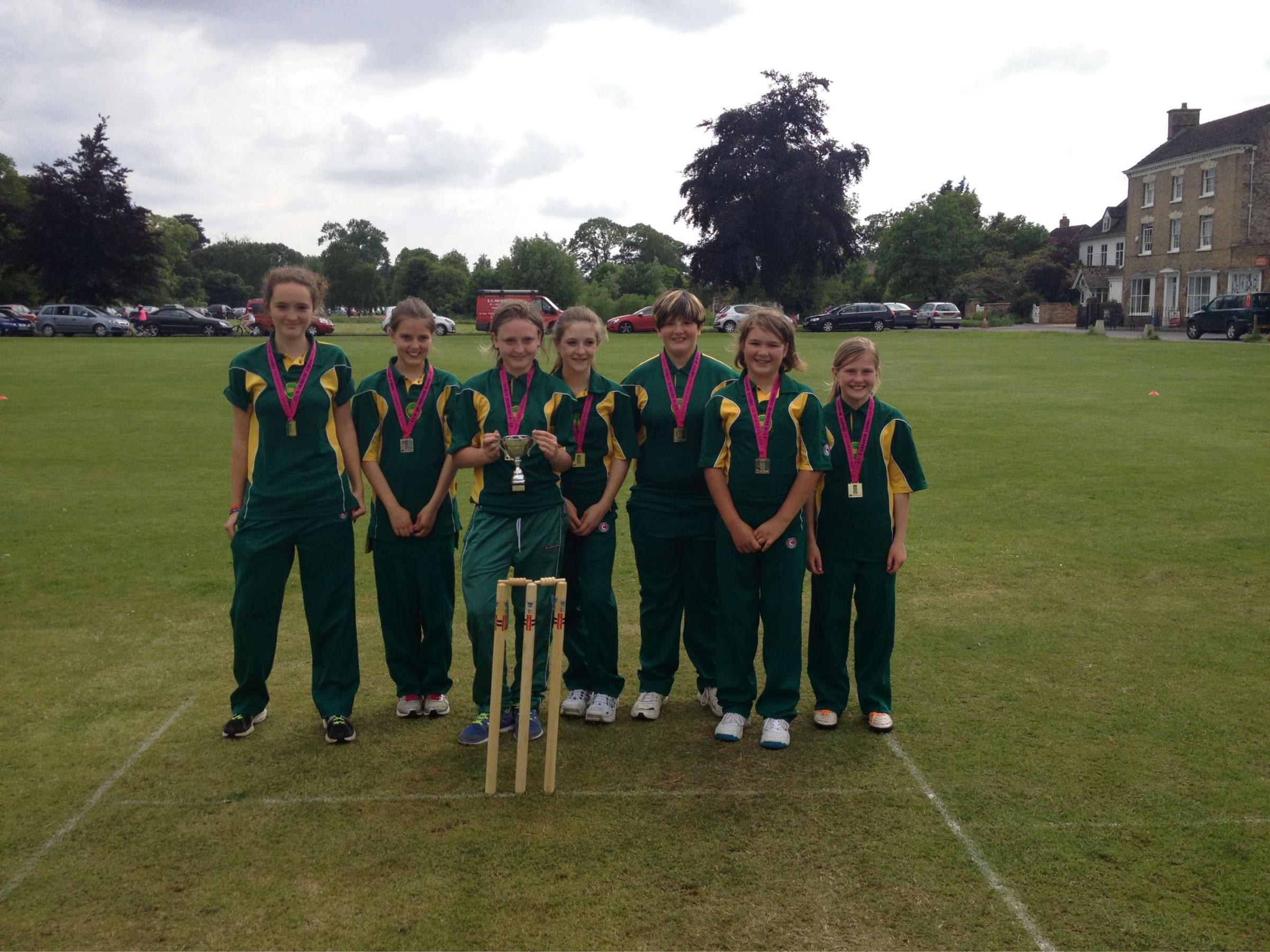 Cam U13 girls show off their medals after a good day in the field and with the bat on the beautiful green spaces of Frampton-on-Severn