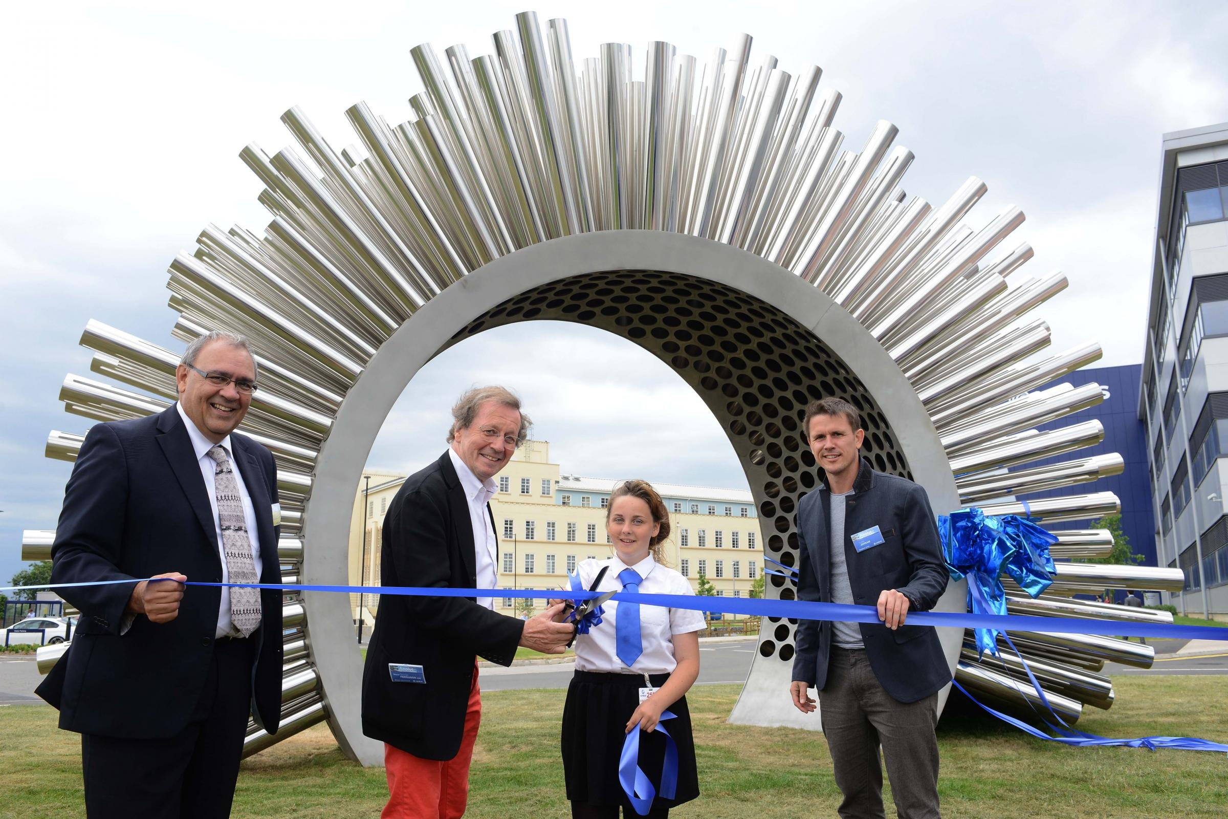 Bristol's elected mayor, George Ferguson cuts a ribbon in front of the Aeolus sculpture, helped by Lauren Edwards 14, from the Orchard School, Monks Park. Also pictured are Behrooz Barzegar, left, head of flight physics integration, and sculpture crea
