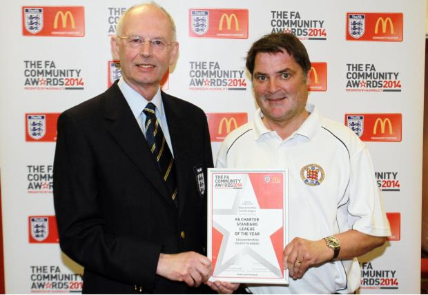 Roger Burden, FA vice-chairman and chairman of Gloucestershire FA, presenting the award for FA Charter Standard League of the Year to Mark Simpson representing Gloucestershire County League. Picture by Carl Hewlett/TWM - Thousand Word Media