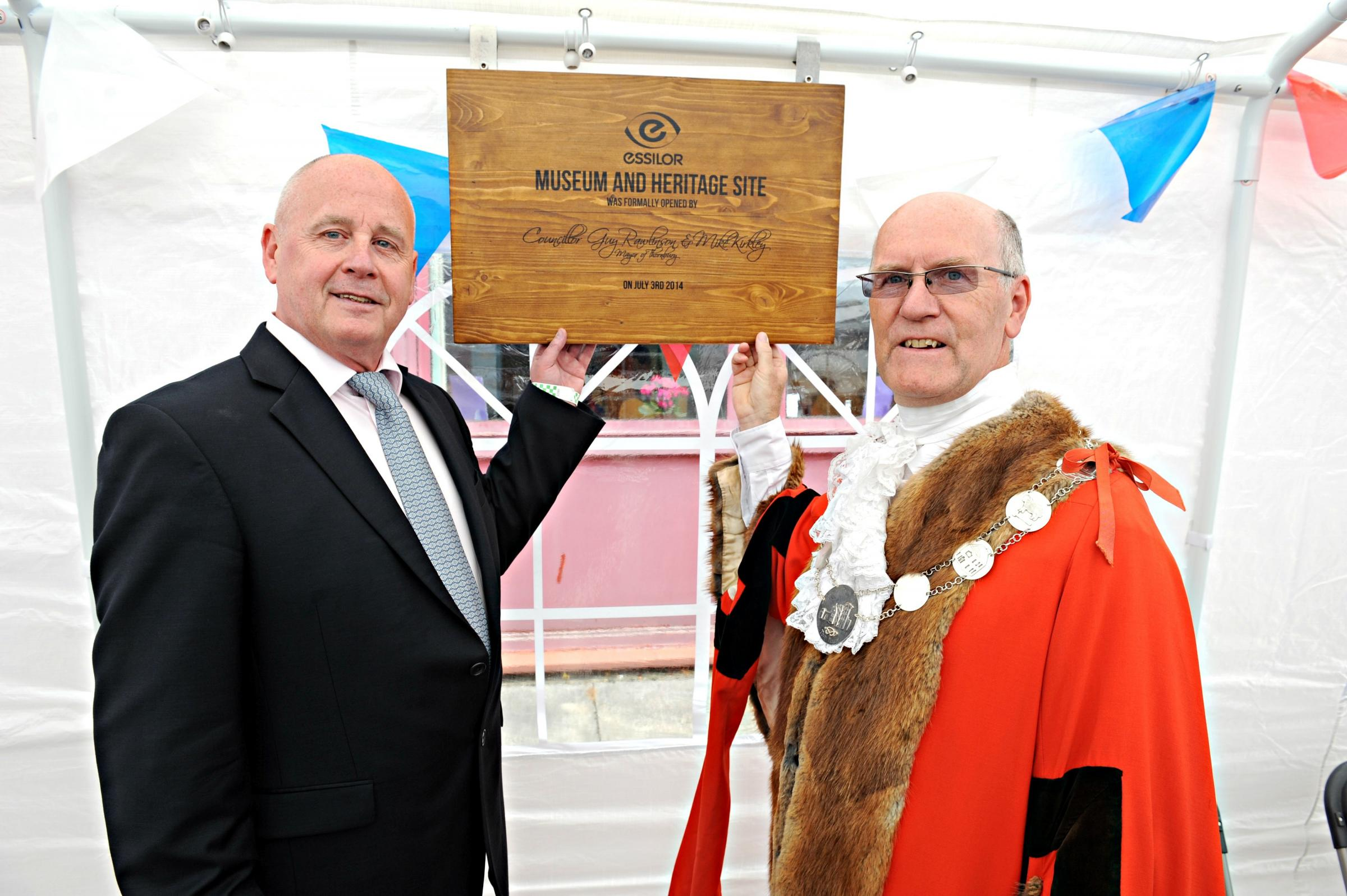 SR_117_001     Thornbury Mayor Cllr Guy Rawlinson unveiled a plaque with Mike Kirkley, Managing Director of Essilor in Thornbury, to celebrate the companies 40th anniversary in
