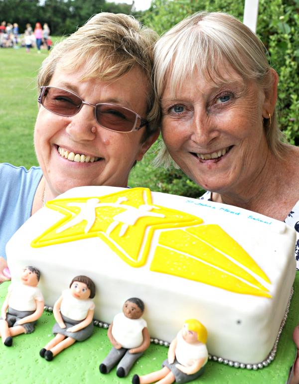 Liz Jones and Val Wingrove with the prize cake in the cake stall raffle at St John's Mead school fair in Chipping Sodbury on Saturday