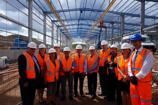 Local councillors and dignitaries join Hitachi Rail Europe staff at the construction site of a new electric rail maintenance depot in Stoke Gifford