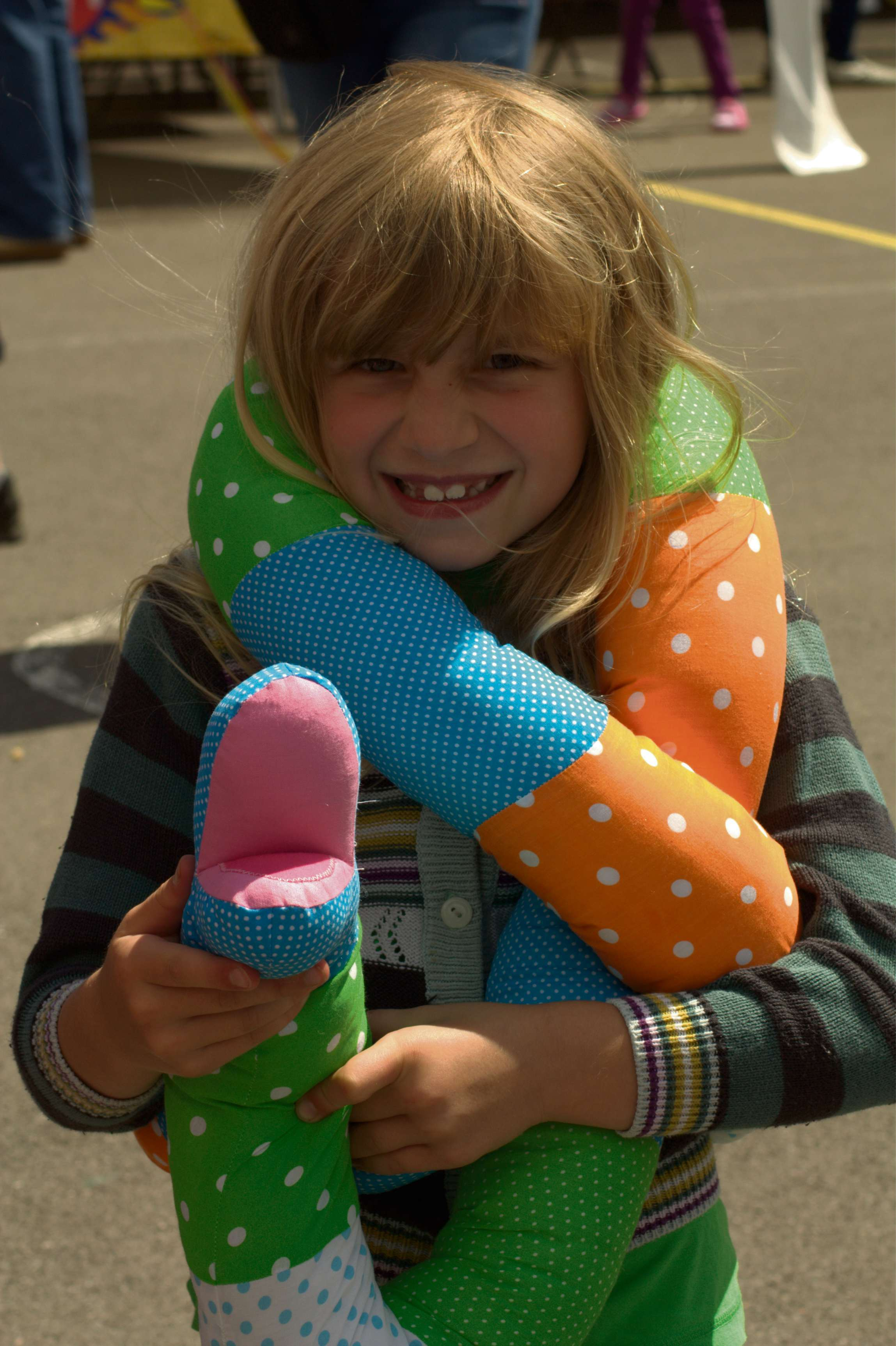A  Berkeley Primary School student enjoys her prize from the school's summer fair(7968905)