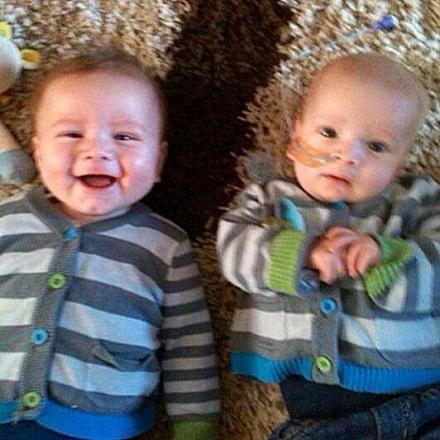 Theo, right, and twin brother Ollie, now aged four