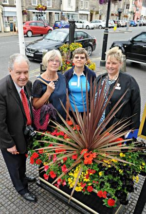 Jane Lund and Julia Bernau of Sodbury in Bloom with South West in Bloom judges Barry Cruse, left, and Nicola Ware, right, during their walk around Chipping Sodbury on Wednesday