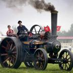 Gazette Series: LADIES RACE: Helen Grahham from Markington tries her hand at racing this 1908 Fowler general purpose steam engine belonging to Mark Edwards from the Isle of Man at the Masham Steam Fair. Picture: ANDY LAMB