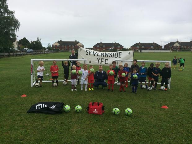 Severnside Youth FC players with coaches, Cameron Elliott (front) and Richard Wade with their new equipment, funded by Magnox (8490599)