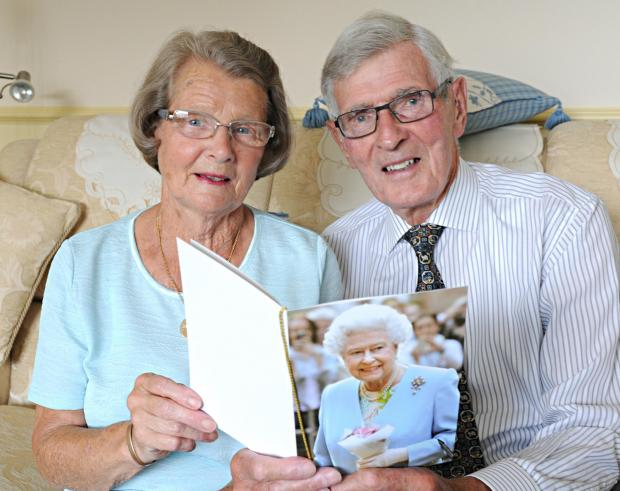 SR_277_001     Judith and Theo Sparrow of Cam with a card from the Queen celebrating their 60th wedding anniversary (8581348)