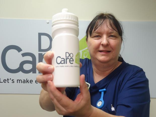 DoCare Specialist Team Leader Deb Atkins with the new water bottle