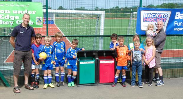 Representatives of Wotton Community Sports Foundation and Wotton Rovers FC showing off the new bins
