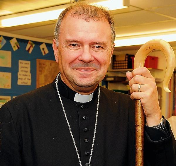 Bishop of Gloucester quizzed by police over historic indecent assault claims against a woman and girl
