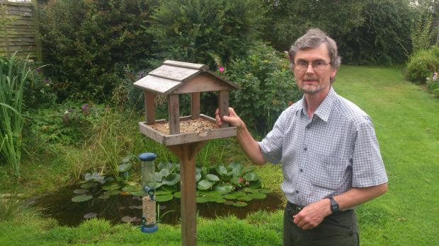 Dr Clive Moforth has received arson threats in reaction to his plans to curb cat numbers in his now bird-free garden
