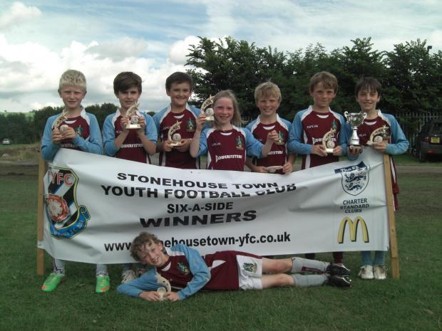 Wotton Rovers under-9s with their trophies