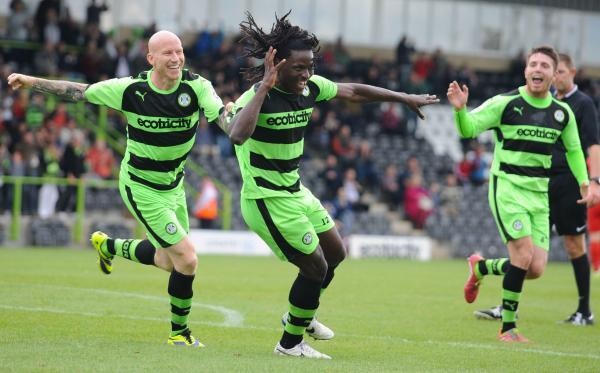 Goalscorers Lee Hughes and Clovis Kamdjo celebrate the second goal