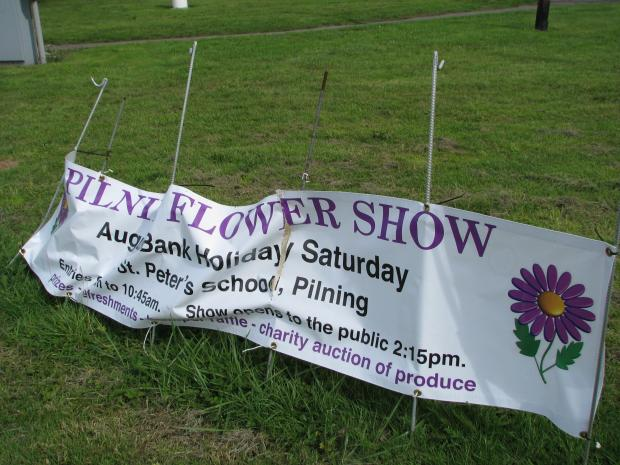 A banner publicising this week's Pilning Flower Show was ruined by vandals (9387390)