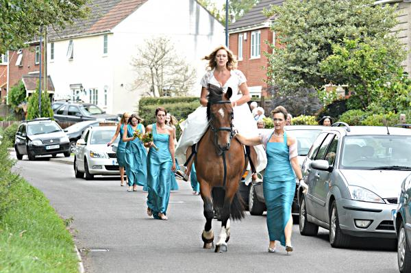 Bride canters to the church on time
