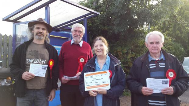 From left, Labour Party members  Labour's Cllr Paul Denney, John and Hilary Fowles and Harry Atkinson protesting outside Cam and Dursley station following an increase in rail fares