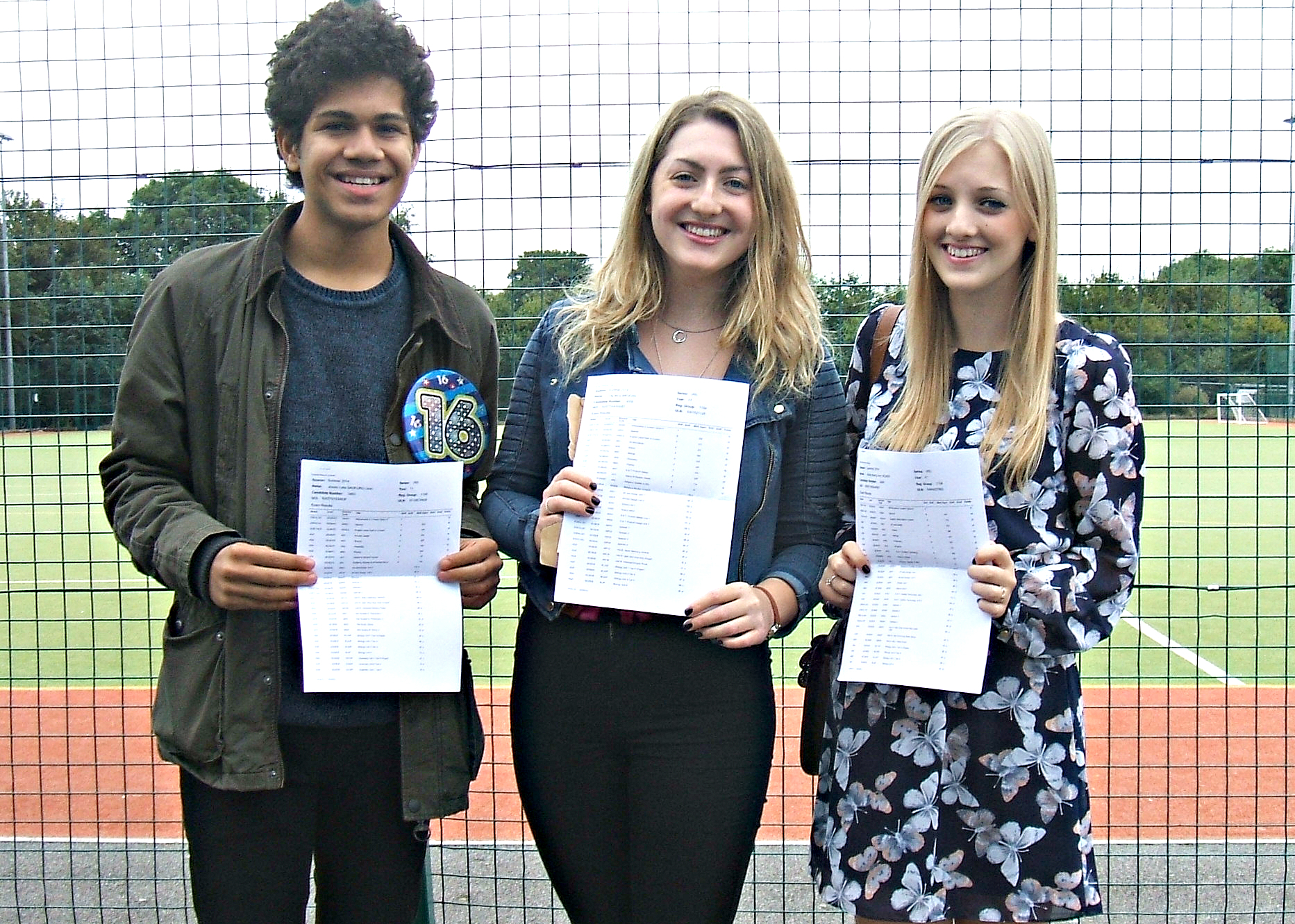 Birthday boy Joe Sauturu, Tilly Brogan and Holly Vicker, all 16, celebrate their results at Winterbourne International Academy