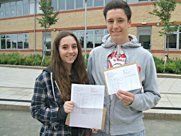 Twins Megan and Joe Wood, 16, with their results at Yate International Academy