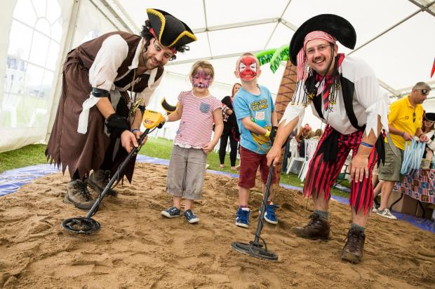 The Merlin Housing residents fun day 2014. Pirates Cain, 6, and Leeloo Vigurs, 4. August 2014. Photographer Freia Turland e:info@ftphotography.co.uk m:07875514528 (9578513)