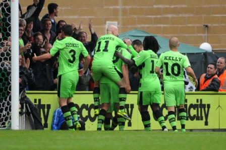 Forest Green players celebrate Jon Parkin's goal               Pic: Tom Wren