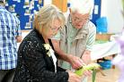 Judges Dot Culverhouse and Donald Harris taking a closer look at one of the sweetcorns entered in last year's show
