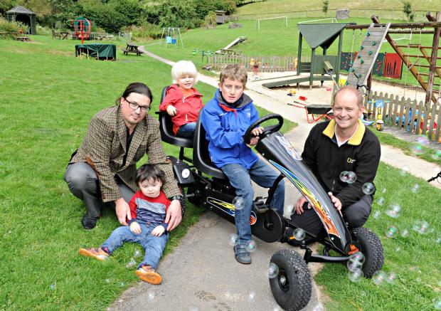 SR_490_001     Adam Brown of LV Insurance with his son Dylan,2,, Oscar Phillips,3, Ban Rayfield,8, and his dad Stuart with the new go kart given to the Bournstream Trust by LV (9559167)