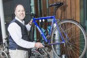 Bristol and Bath Science Park Innovation Centre director Richard Pitkin using the 'Fixit' bicycle air pump stand at the Science Park
