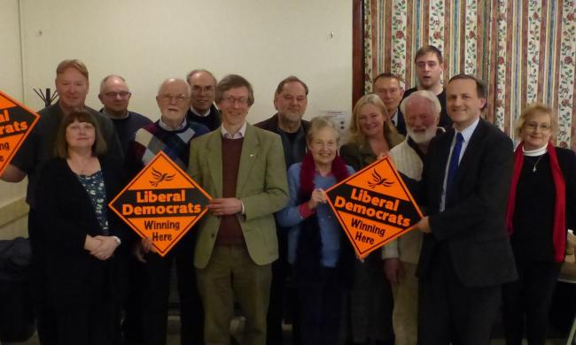 Pete Bruce (centre, green jacket) and Steve Webb MP (right) with supporters at Friday night's meeting. (17546522)