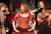 Laura Cooper as Nancy singing with Fagin's lost boys at the DODS production of Oliver!
