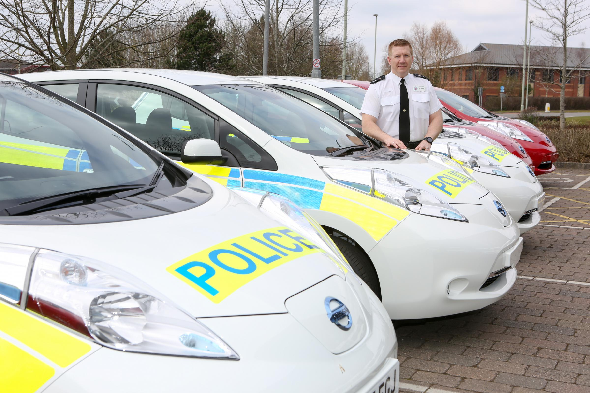 Chief superintendent of Gloucestershire Police Gary Thompson with the new Nissan Leafs
