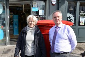 Cllr Maggie Tyrrell and Mike Horton in front of the post box on Thornbury High Street