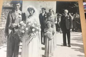 Can you help reunite wedding photo found hidden behind print with its owner?