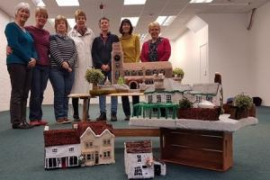 Members of Knit and Knatter with some of the buildings from the Woolbury project